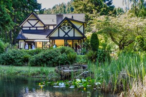 an old English Tudor style house hosts viewers of its flower garden