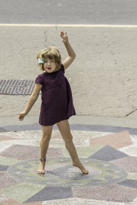 young girl dances by herself