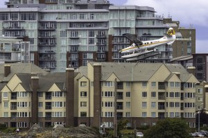 seaplane approaching landing in front of buildings