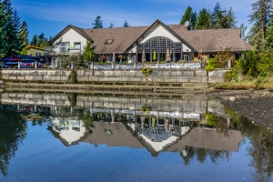 a seaside restaurant reflecting on calm waters in HDR