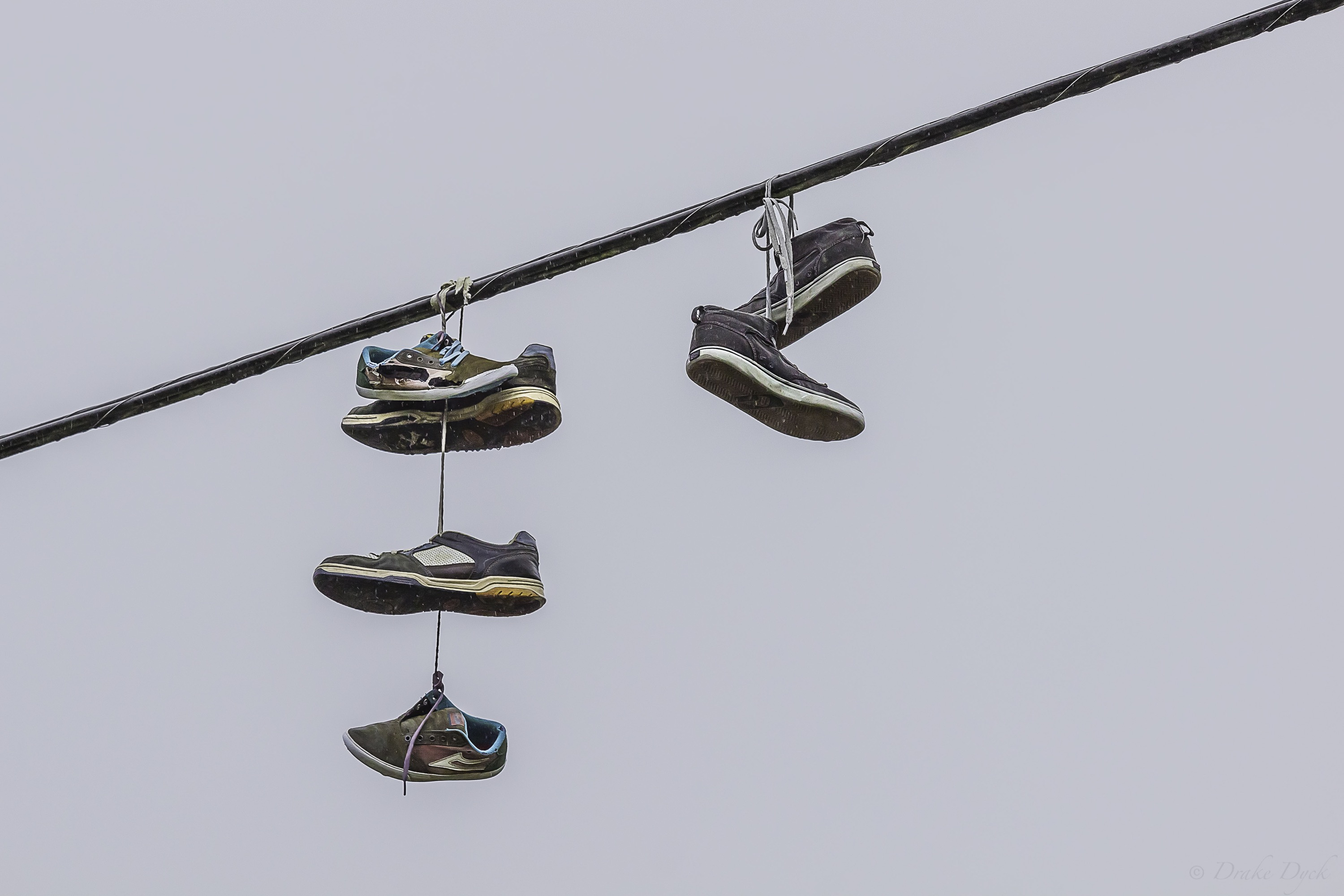 multiple shoes caught up on power wires