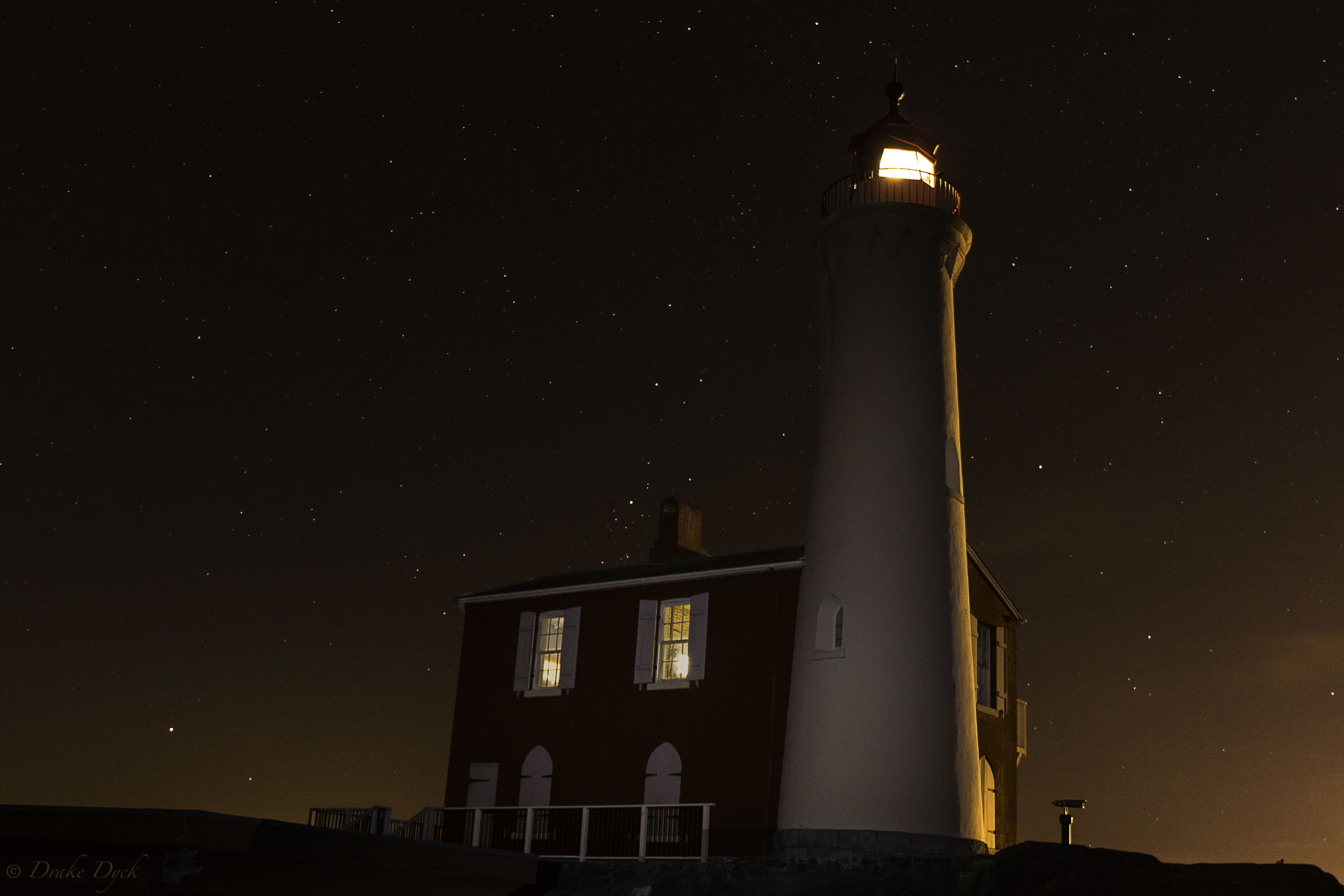 Fisgard Lighthouse after dark with stars in the sky