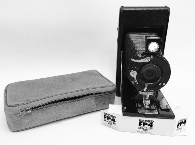 Pocket Ensign bellows camera with case and Ilford film