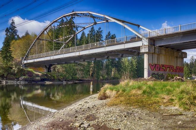 bridge reflecting on the river