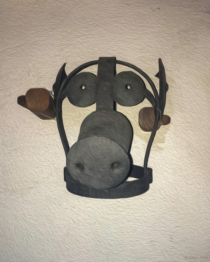 pig shaped iron mask that bolts on to a human head