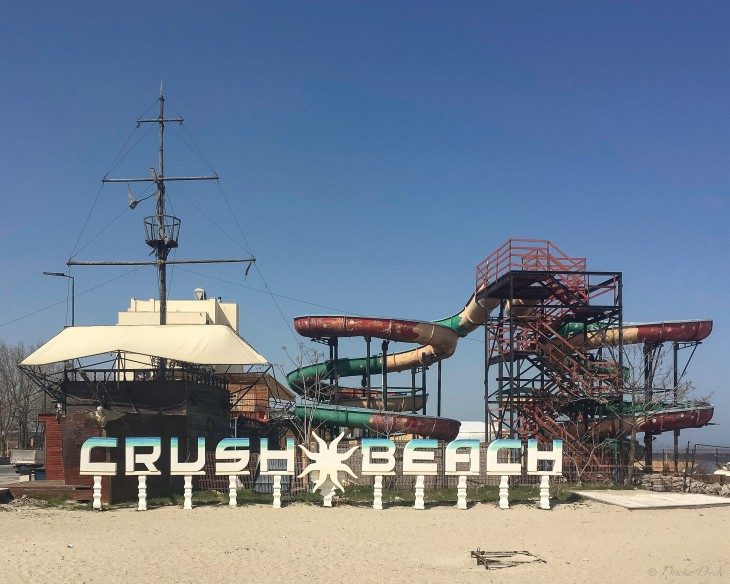 rundown amusement park on the beach