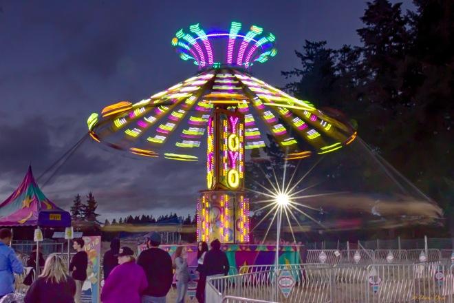 ride at the fall fair spins