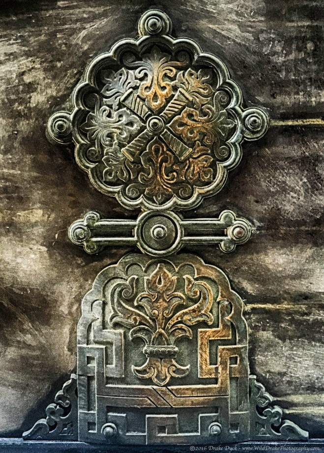 ornate brass door hinge