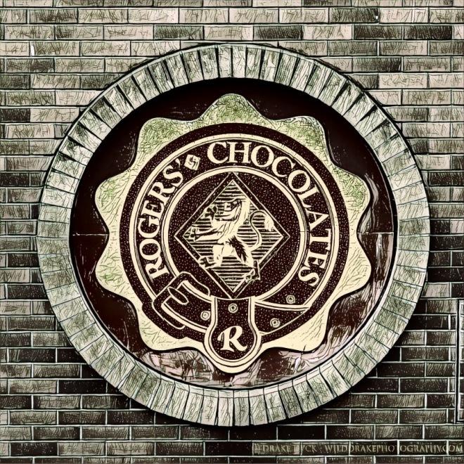 Brick circle around Roger's Chocolate sign