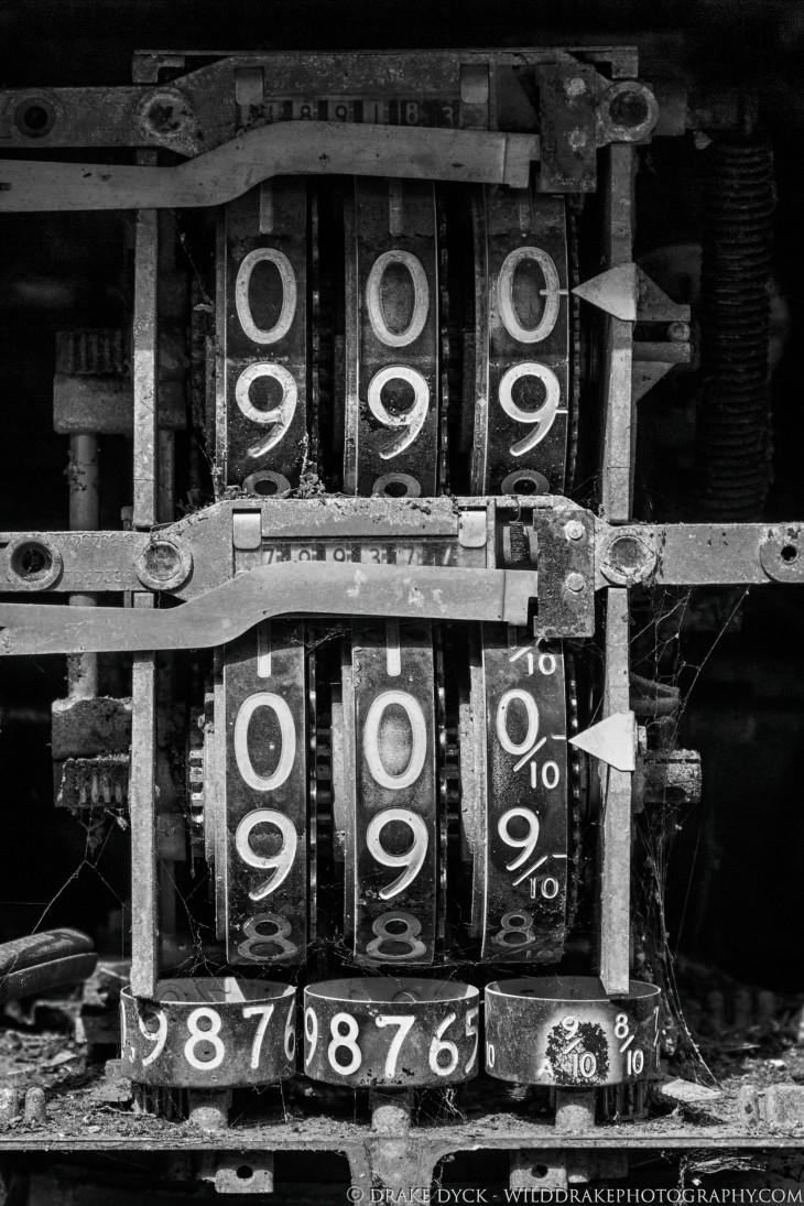 numerical dials form the guts of a broken down gasoline pump