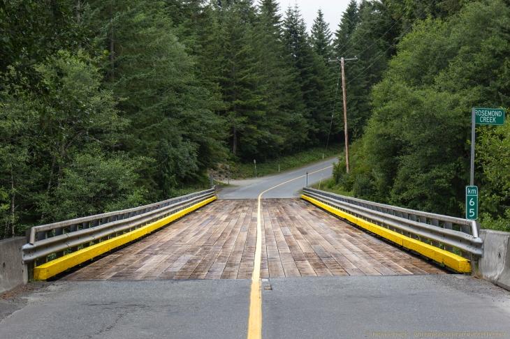 a wood plank bridge crosses Rosemond Creek