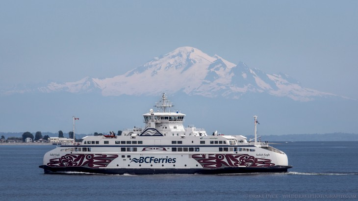 a BC Ferry crossing the Salish sea in front of a dormant volcano