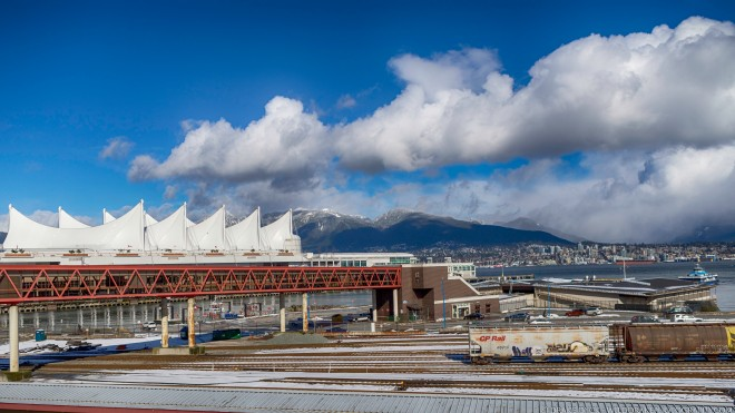 Canada Place, Seabus terminal, mountains, trains, partly cloudy