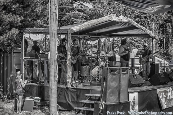 a band plays on a temporary stage